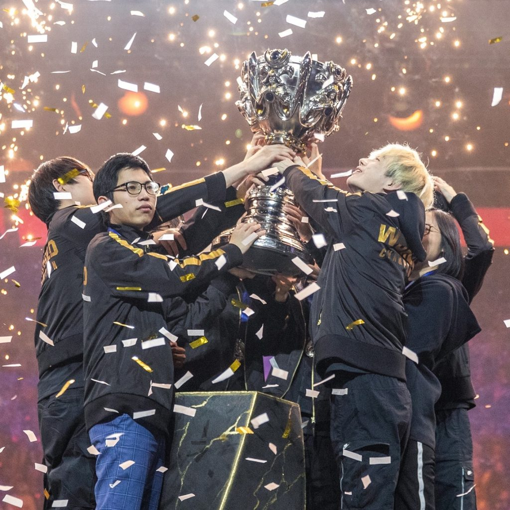 FunPlus Phoenix lifting up the trophy after winning the 2019 League of Legends World Championship.