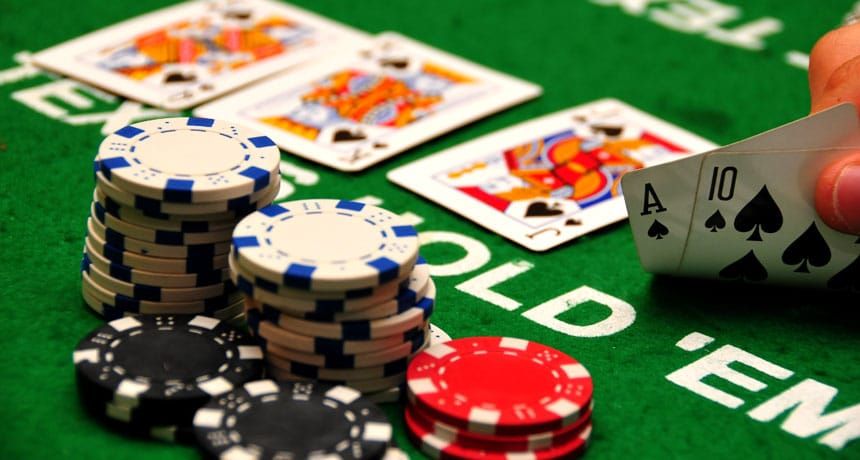 A game of Poker with a winning hand and some Chips in between