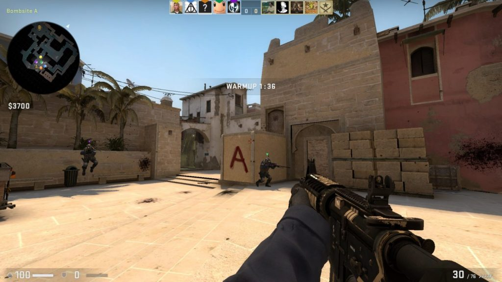 Counter-Strike GO gameplay screenshot, showing weapon handling and a desert map.
