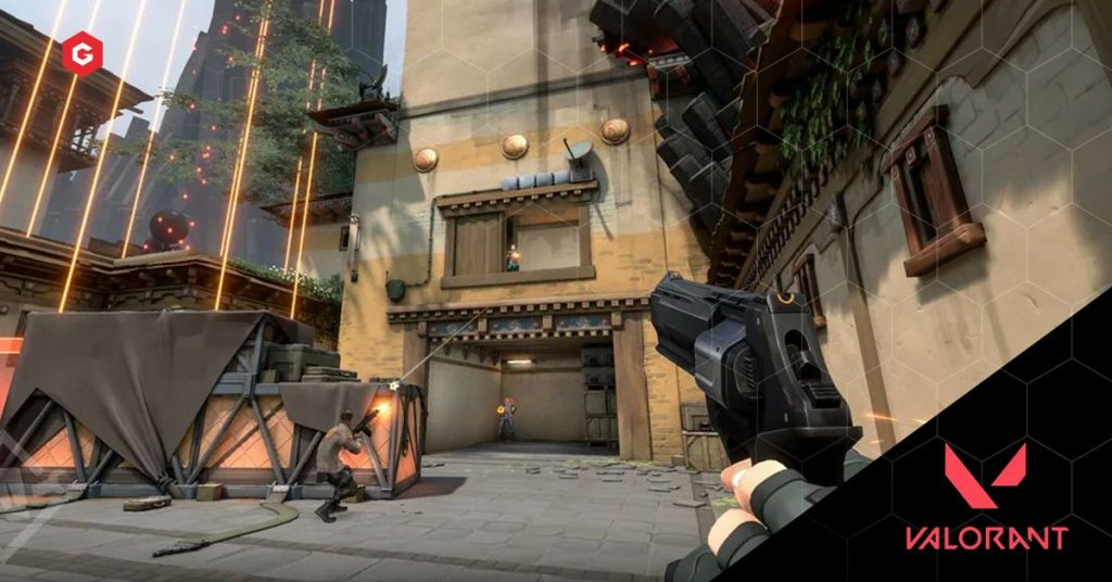 Valorant gameplay screenshot, showing weapon handling, teammates and current art style.