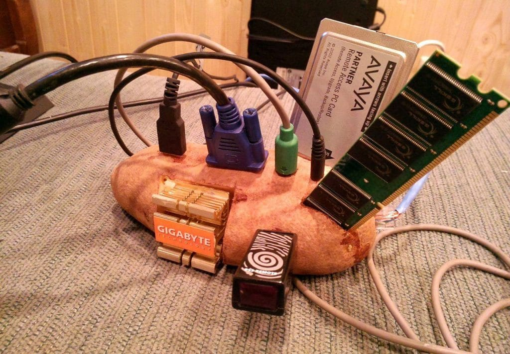 A potato Pc Meme. It depicts a potato vegetable with different PC hardware attached around it.