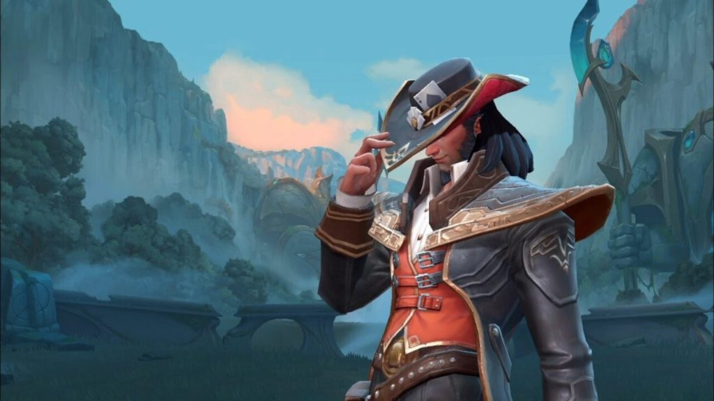 Twisted Fate in-game Model adjusting his hat with the right hand. Forest and mountains in the background.