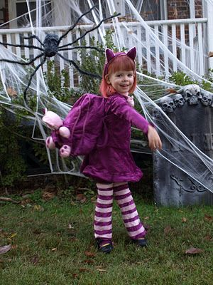 A little girl cosplaying Annie for halloween