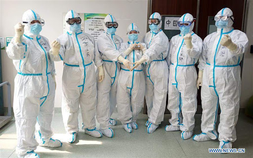 Random people with protecting attire that reduces the coronavirus contagion.
