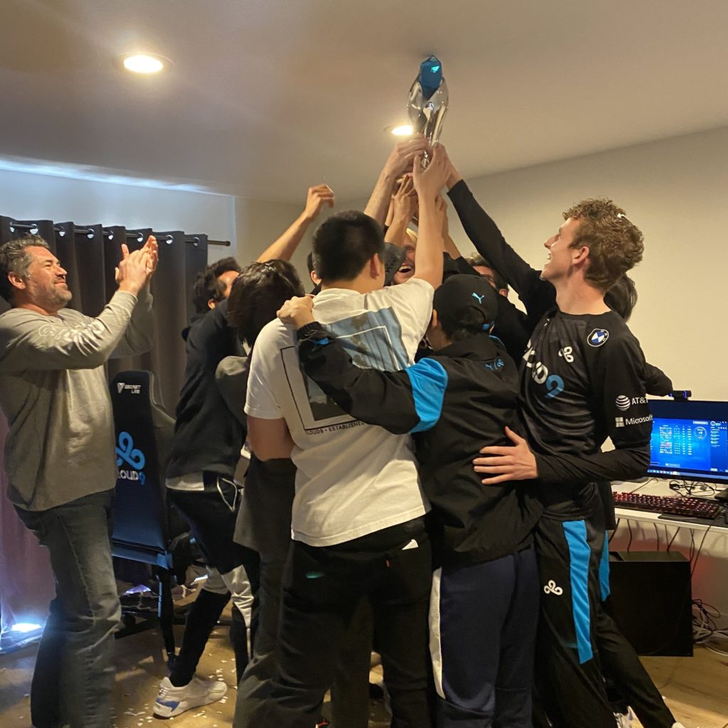 Cloud9 Lifting up the trophy inside their HQ after winning the spring split