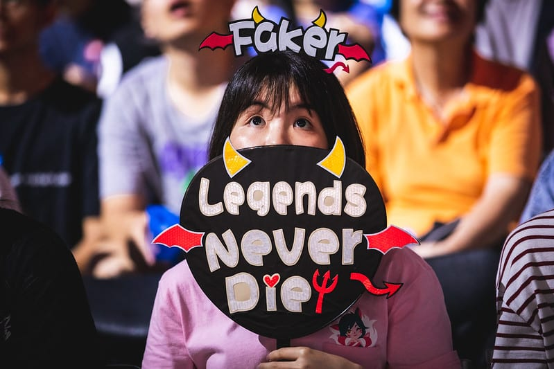 A fan holding up a Faker sign