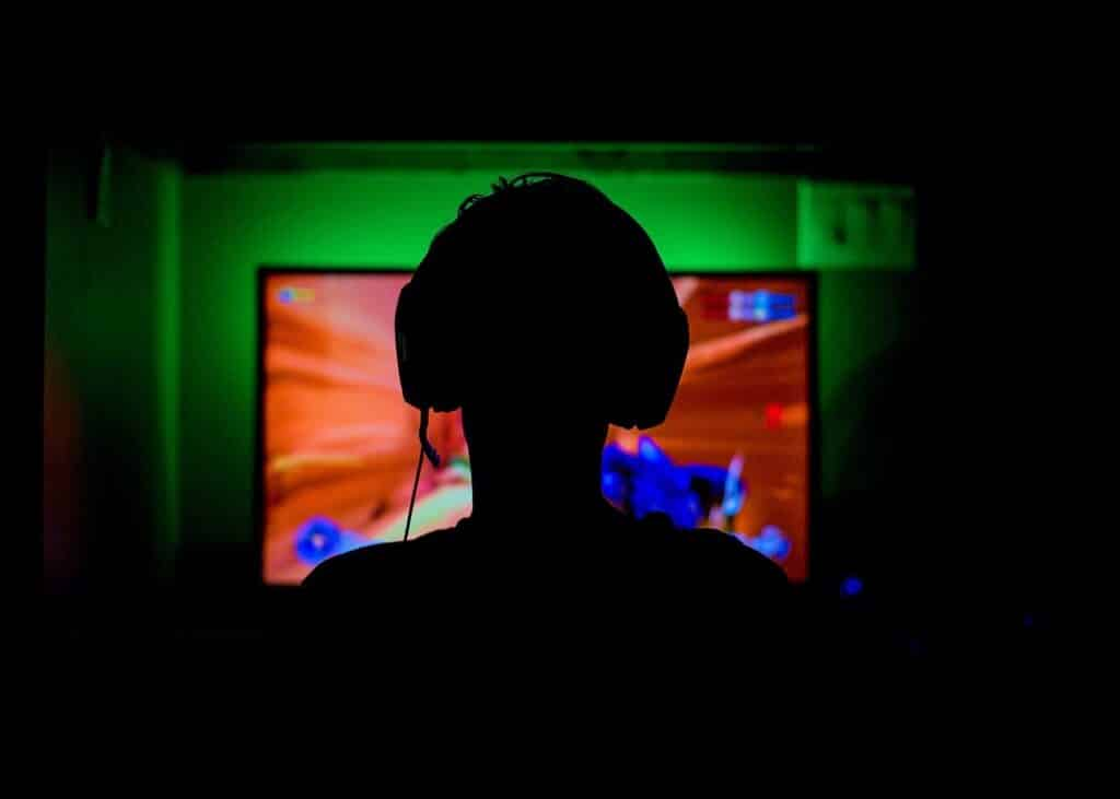 A gamer's silhouette playing computer games